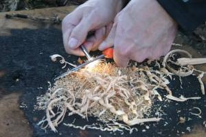 Learning to light wood shavings is essential for later advancedment of the skill